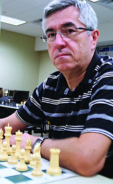 Moving forward: Chess coach's journey to UTD