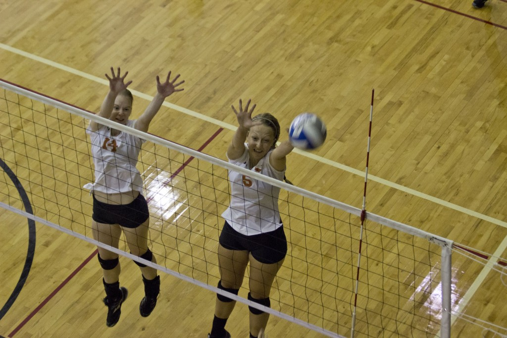 Marcelo Yates  Staff Photographer Senior middle blocker Taylour Toso (right) and freshman middle blocker Emma Wallbrown (left) go up to block the ball as it comes over the net at the Labor Day tournament on Aug. 29 and 30. The team was tabbed to finish second in the ASC, according to the league's preseason poll.