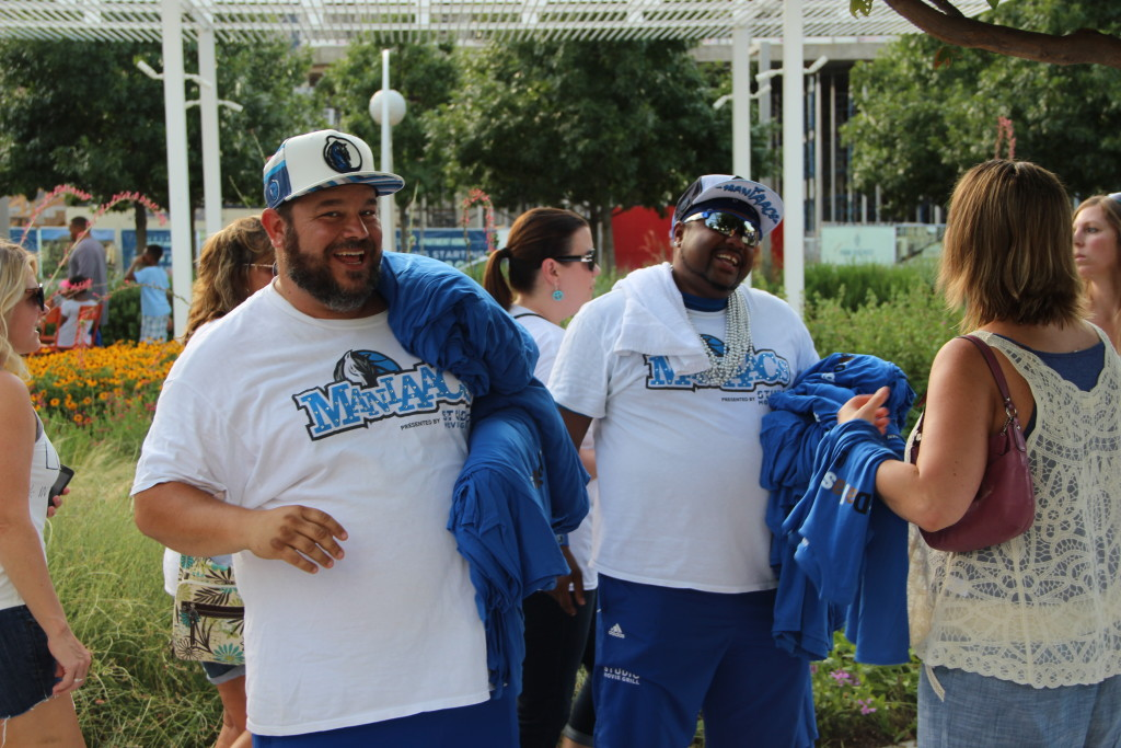 "Two Mavs ""Maniaacs"" helped pass out shirts at ""Love in the Streets"" that read, ""#DallasStrong."""