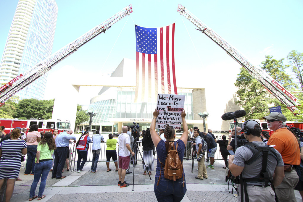 People begin to gather at the Morton H. Meyerson Symphony Center for the interfaith memorial service that honored the five officers who lost their lives in last week's shooting in downtown Dallas.