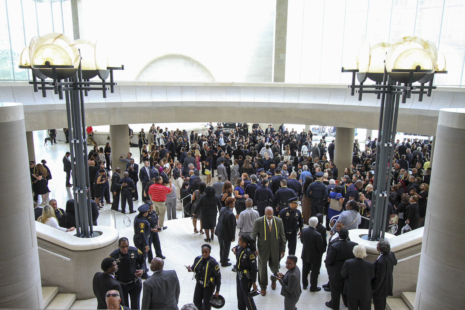 Crowds of officers and civilians gather outside the Morton H. Meyerson Symphony Center at the conclusion of the interfaith tribute.