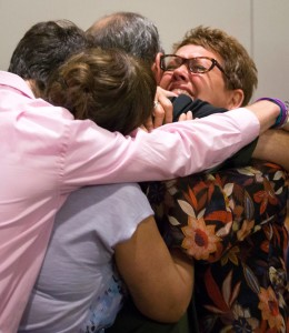 Morris' mother, Jonni McElroy is embraced by the Morris family — courtesy Smiley N. Pool, Dallas Morning News