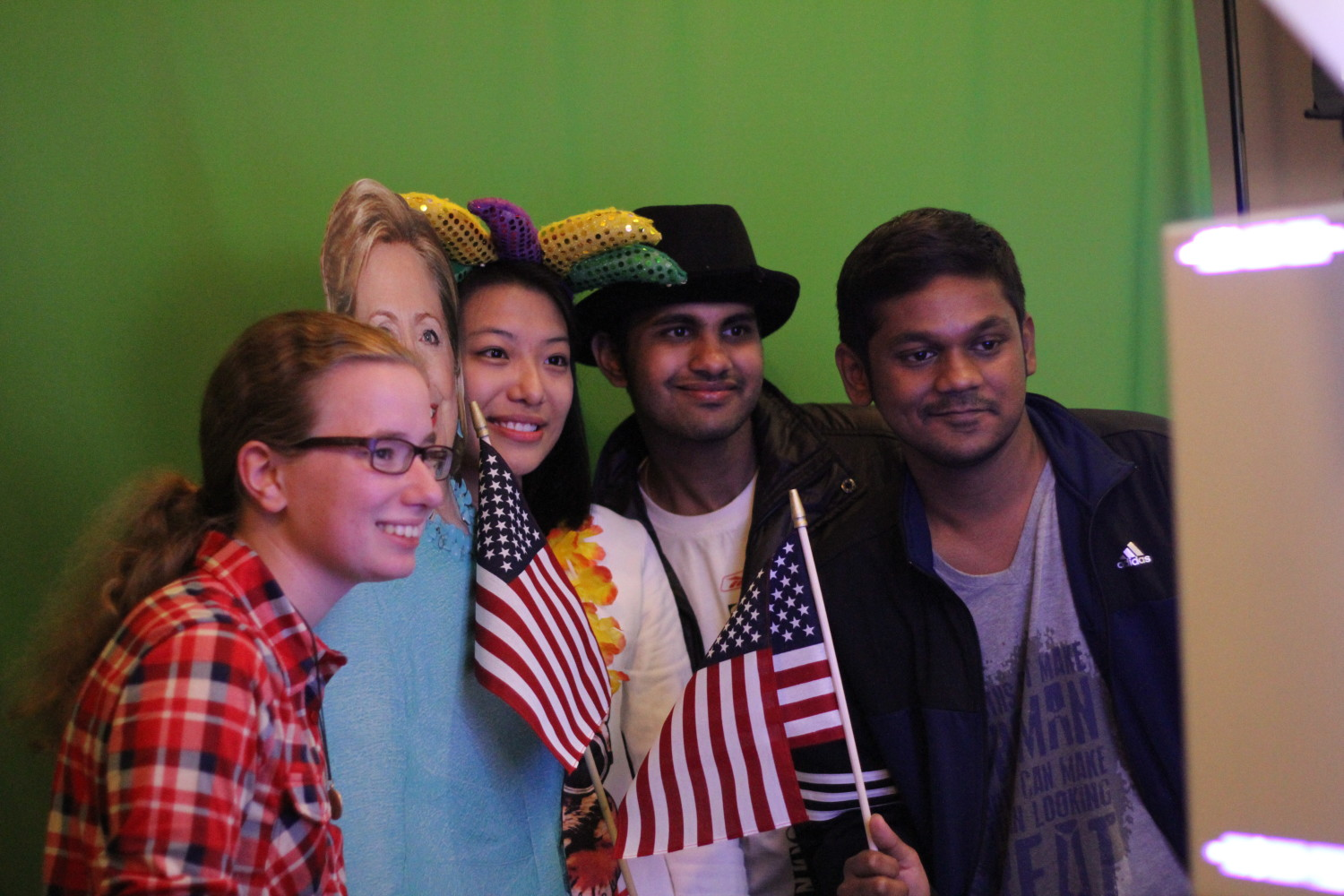 Political science sophomore Madeleine Keith (left), marketing graduate student Haiyun Chen, business analytics graduate student Ganesh Kumar and management science graduate student Naman Bader pose with a Hillary Clinton cutout at the election watch party.