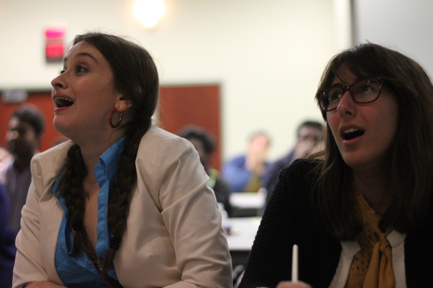 EMAC freshman Jules Rosen (left) and geoscience senior Hannah Ghotbi cheer as their preferred candidate takes the lead.